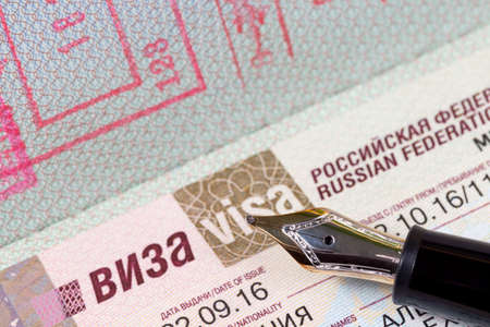 german passport with visa to the Russian Federation with fountain pen