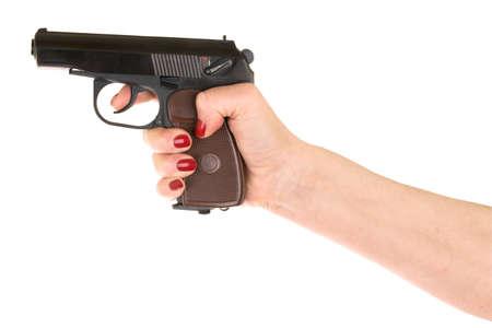 female hand holding gun over white
