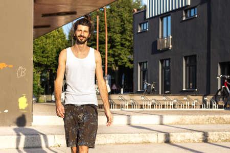 hipster man in tanktop, walking