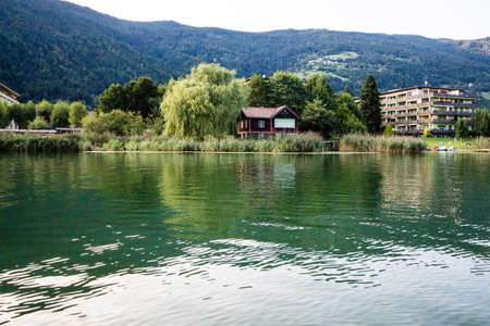 tranquil scene by a lake in the mountains Stock Photo