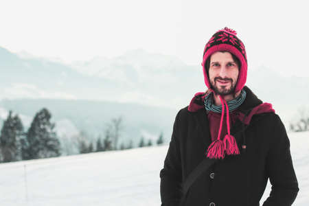 young man looking confident in winterscape Stock Photo