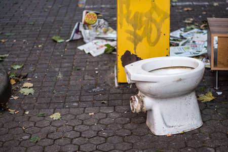 Dirty toilet bowl outdoors in the city