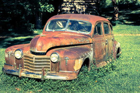 rusty car: rusty old timer car in nature