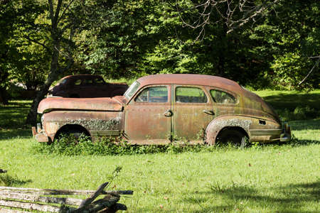 rusty old timer car in nature