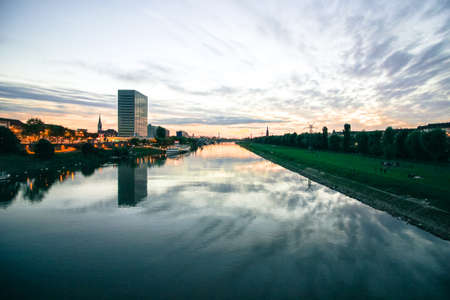 scenic sunset over a river in a city in germany 스톡 콘텐츠
