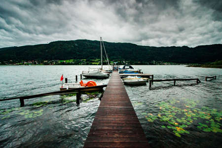 wooden pier on a quiet lake with bad weather coming up