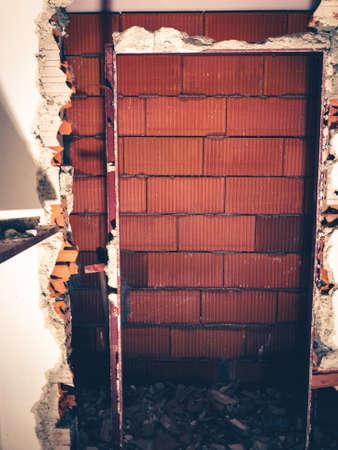 red brick walls and tearing down a wall