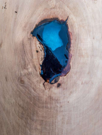knothole in cherrywood filled with cast resin
