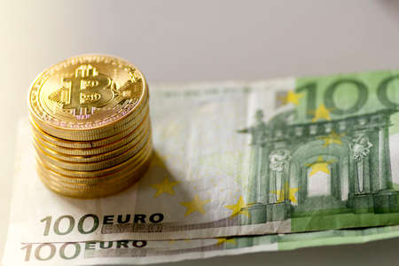Bitcoin cryptocurrency and euros - Stock image