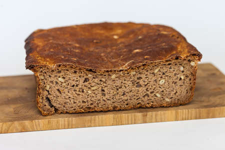 Rye homemade bread on wooden cutting Board on white background