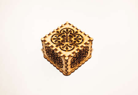 plywood: The box is made of plywood with a pattern cut by laser cutting on a white background