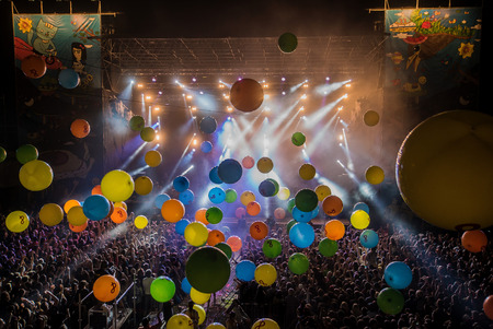 large colorfull balls during the concert in front of the stage at the festival 스톡 콘텐츠