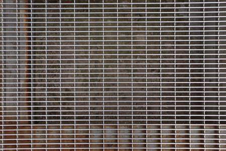 gratings: Metal gratings. Steel weathered doorstep cells.