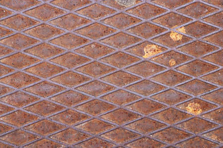 Rust metal hatchway. Urban city street art.