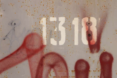 numeric: Rust Painted Wall Texture. Number 1318. Red Spray. Stock Photo