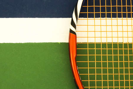 Tennis Racket on Playground Court Markup. Sport Background.