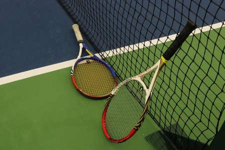 Two Tennis Rackets near Net on Playground Court. Sport Background.