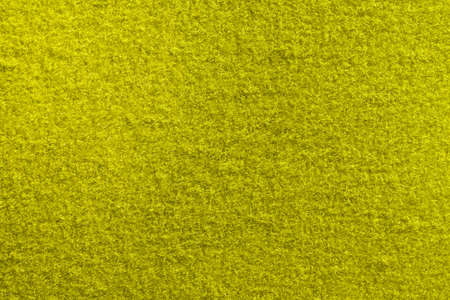 Yellow Fleecy Material Texture. Detailed Fibers Fluffy Surface Background.