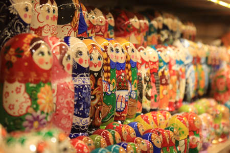 A lot of souvenirs of nesting dolls. Many colored nesting dolls.