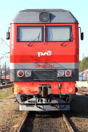 Red locomotive cabin. Train front part. Rail transport vehicle. Redakční