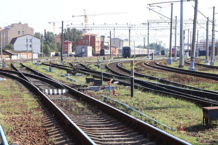 Railway tracks surrounded with buildings Stock Photo