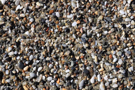 Sea little pebble texture. Beach stones surface. Marine mineral beauty harmony. Reklamní fotografie