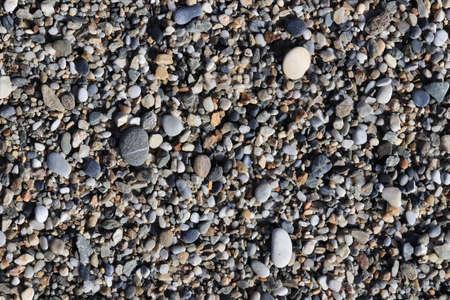 Sea pebble texture. Beach stones surface. Marine mineral beauty harmony.