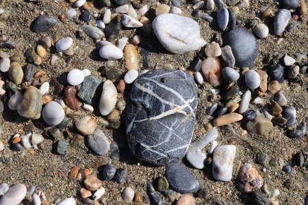Beach stones surface. Sea pebble with cobblestones texture. Marine mineral beauty harmony.