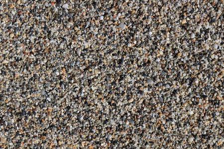 Beach stones surface. Sea little pebble texture. Marine mineral beauty harmony.