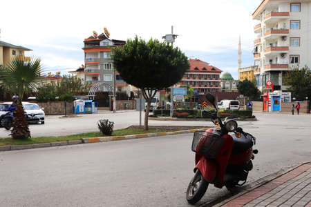 Residential square in the Alanya city with parked scooter. Turkey.