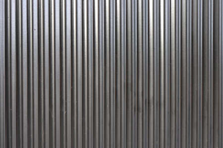 Corrugated steel fence wall texture