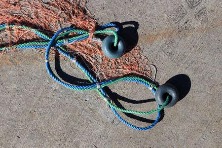 Fishnet with two buoys on rope. Nautical marine background. Stock Photo
