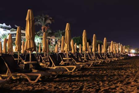 Closed beach umbrellas. Night long exposure. Alanya. Turkey. Stock Photo