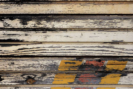 Weathered painted planks texture. Old wooden background. Horizontal along direction. Stock Photo