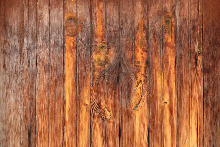 Weathered plunks texture. Stained wood background. Vertical cross direction. Stock Photo