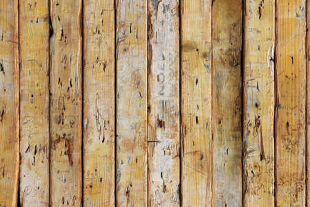 Weathered rough wooden background. Old planks texture. Vertical cross direction.