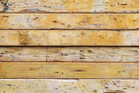 Weathered rough wooden background. Old planks texture. Horizontal along direction.