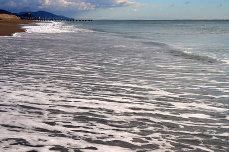 Long water surface after closing wave. Shoreline seascape background.