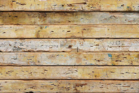 Weathered planks texture. Old grunge wooden background. Horizontal along direction.