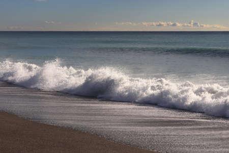 Calm sea beach with splashing wave seascape.
