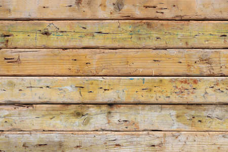 Weathered planks texture. Old rough wooden background. Horizontal along direction.