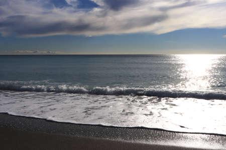 Calm sea beach with sunlight background Stock Photo