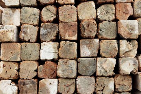 Lumber butts texture. Rough grunge wooden background.