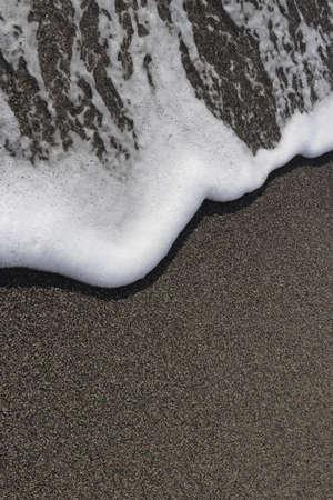 Sea beach texture with wave foam. Marine background.