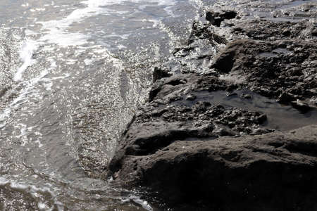 Sea water with cliff in sunlight seascape. Stok Fotoğraf