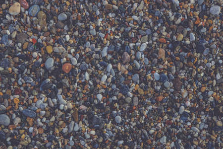Beach stones surface. Sea pebble texture. Marine mineral beauty harmony.