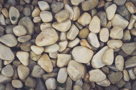 Beach stones surface. White sea pebble cobblestones texture. Marine mineral beauty harmony.