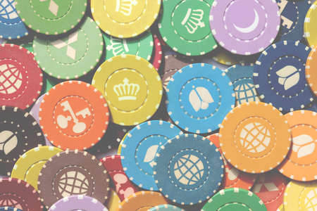 Colorful casino chips background. Many colored chips backdrop. Lot multicolor assorted gambling playing chips surface.