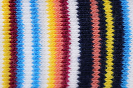 Color knitting fabric background. Colored knit textile texture.