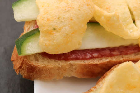 Sandwiches with bread slices cheese avocado and crisps. Filling background. 版權商用圖片